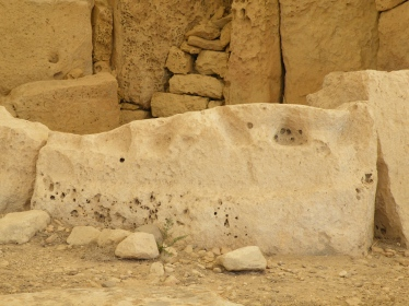 One of the stone slabs forming the wall in this chamber bears two pairs of legs in high relief